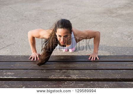 Strong Female Fitness Athlete Doing Push Ups Workout