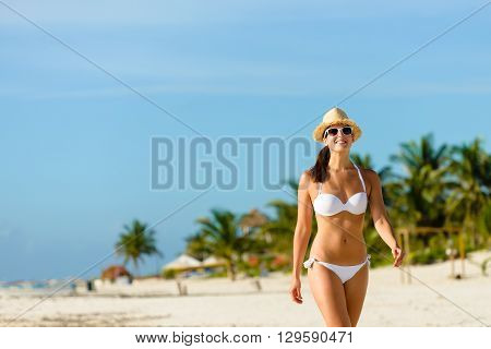 Young Tanned Woman Walking At Tropical Caribbean Beach