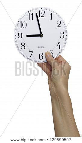 Time keeper - female hand holding up a clock face showing 2 minutes before 9 am isolated on a white background