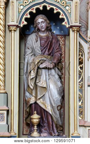 STITAR, CROATIA - AUGUST 27: Saint John statue on the altar of the Sacred Heart of Jesus in the church of Saint Matthew in Stitar, Croatia on August 27, 2015