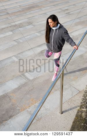 Fitness Woman Stretching Legs Before Urban Workout