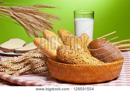 still life with bakery products and glass of milk