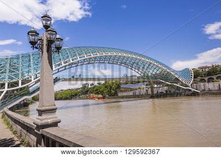 Tbilisi, Georgia - May 07: The Bridge Of Peace Is A Bow-shaped Pedestrian Bridge Over The Kura River
