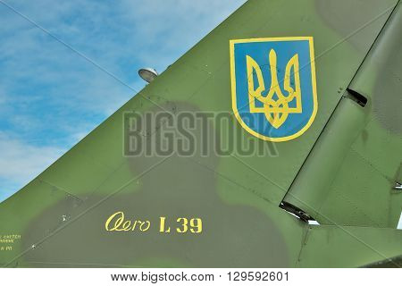 Vasilkov Ukraine - June 19 2010: Ukrainian Air Force signs on the tail fin of a training aircraft Aero L-39 Albatros