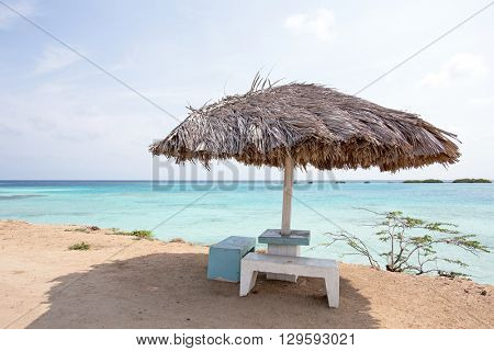 Beach umbrella on Palm Beach in Aruba Caribbean