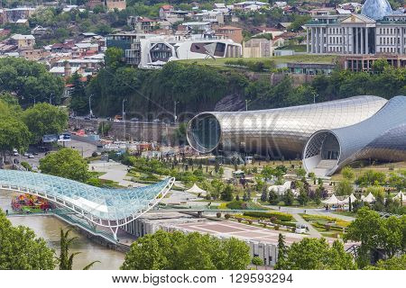 TBILISI GEORGIA - MAY 07 2016: Theater of Music and Drama Exhibition Hall and Presidential Palace are the Modern Tbilisi located in Rike Park Georgia