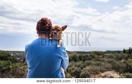 Woman Hugging A Dog