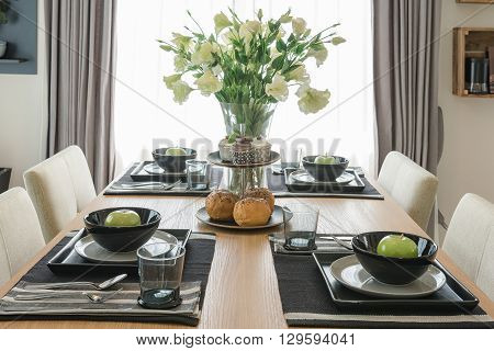 Table Set On Wooden Dinning Table In Dinning Room
