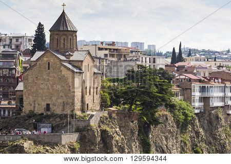 TBILISI GEORGIA - MAY 07 2016: Metekhi Church above the Kura river in Tbilisi Georgia.