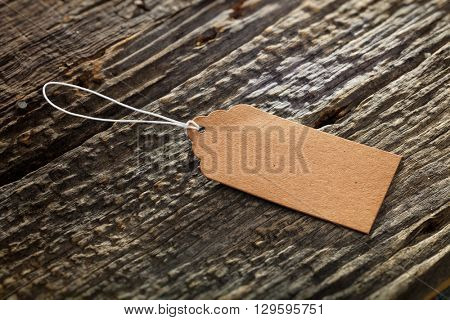 Close-up of carton label on wooden background