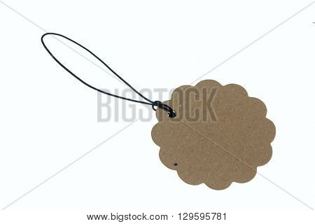Close-up of flower shaped carton tag on rope.Isolated