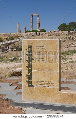 AMMAN JORDAN - JULY 21 2015: Sign at The Temple of Hercules at the Citadel of Amman Jordan. Philadelphia is the former name of Amman.