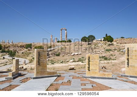 The Temple of Hercules with signs in the foreground at the Citadel of Amman Jordan.