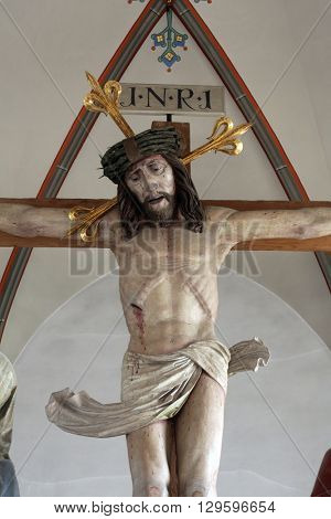 OBERSTAUFEN, GERMANY - OCTOBER 20: Crucifixion, the parish church of St. Peter and Paul in Oberstaufen, Germany on October 20, 2014.