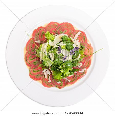 Veal carpaccio with fresh herbs and parmesan. Decorated with flowers. Isolated on a white background.