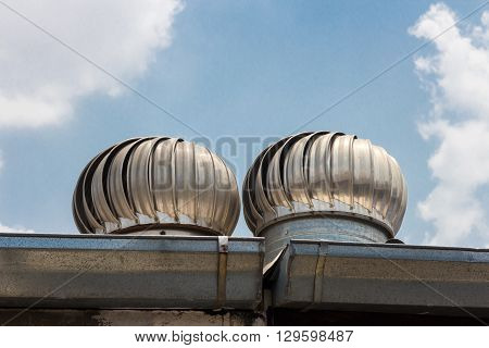 Roof Ventilation on blue sky and cloud background