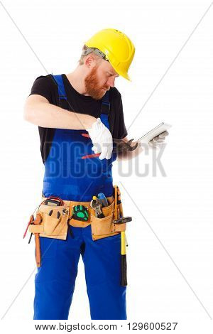 Man Builder In The Uniform With A Tablet