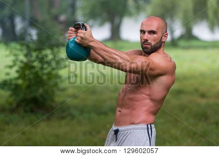 Man During Workout With Kettlebell