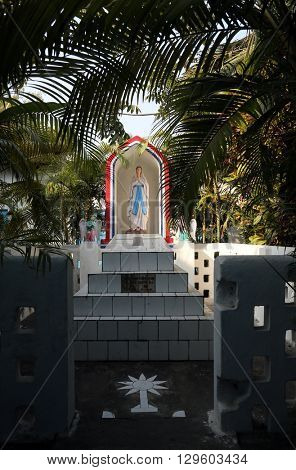 KUMROKHALI, INDIA - FEBRUARY 13: The tomb of the Croatian Jesuit missionary Ante Gabric behind the Catholic Church in Kumrokhali, West Bengal, India February 13, 2014.