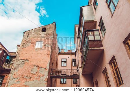 Antique Chapped Vintage Old Arhitecture Yard with BalconyBlue Sky,Toned