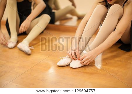Little Girls Putting Their Dance Shoes On