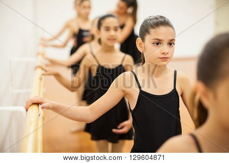 Little Girls Paying Attention To Dance Class