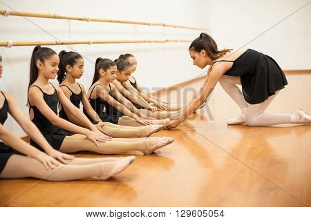 Dance Teacher Helping Students With Posture