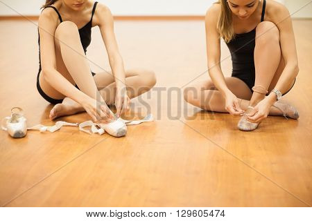 Dancers Putting Their Shoes On