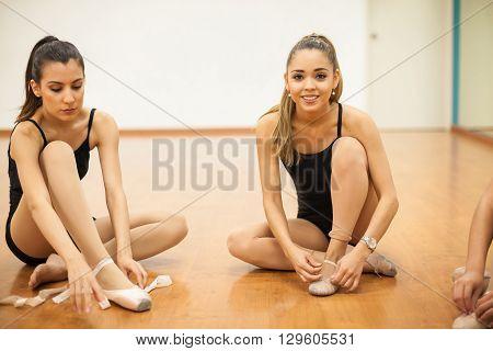 Pretty Female Dancers Getting Ready To Dance