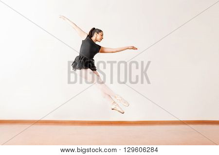 Pretty Ballerina Jumping In A Dance Studio