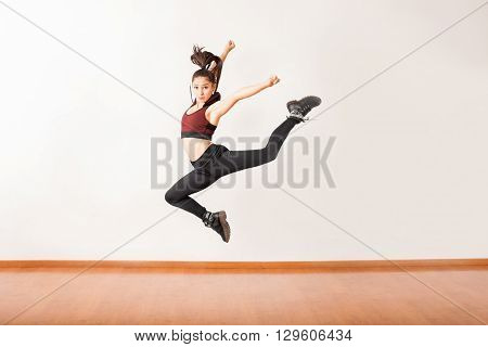 Young Jazz Dancer Jumping In A Studio