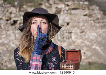 Young Woman Holding A Wooden Box. Shhh!