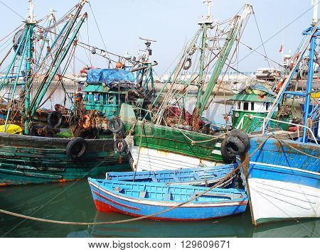 Old fishing boats and motor-boats in the harbor of Agadir. Morocco