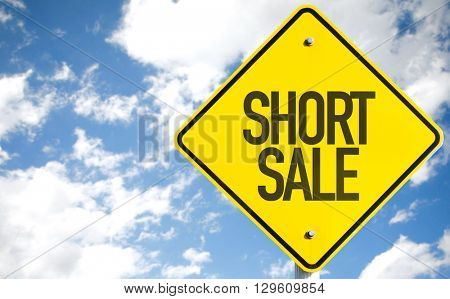 Short Sale sign with sky background