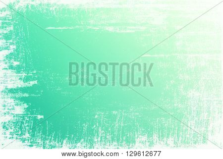 Textured green surface with white grunge edges
