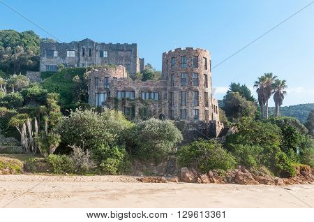KNYSNA SOUTH AFRICA - MARCH 5 2016: Early morning view of houses on the slopes of a hill at the beach in Noetsie built to look like castles