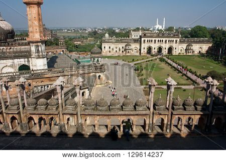LUCKNOW, INDIA - DEC 18, 2012: Top view on the tourists around the beautiful ancient Mughal temple Bara Imambara on December 18, 2012 in Lucknow India. Bara Imambara was built by Asaf-ud-Daula in 1784