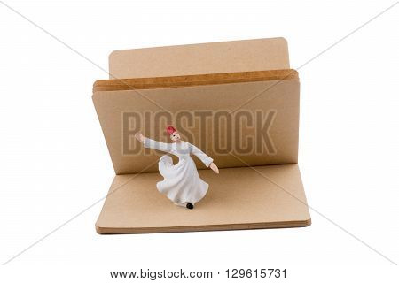 Sufi Dervish on a notebook on white background