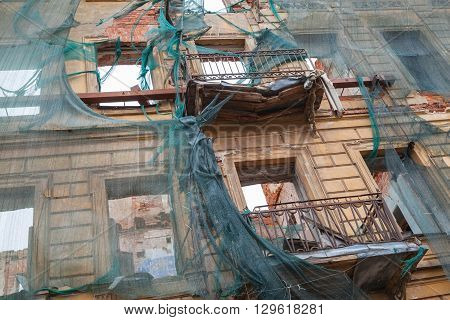 Facade With Broken Balconies Under Renovation