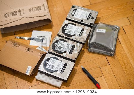 PARIS FRANCE - MAR 18 2016: Four Western Digital Hard disk drive with diverse capacity ranging from 1 tb to 6 tb arranged on floor after Amazon.com product e-commerce unboxing