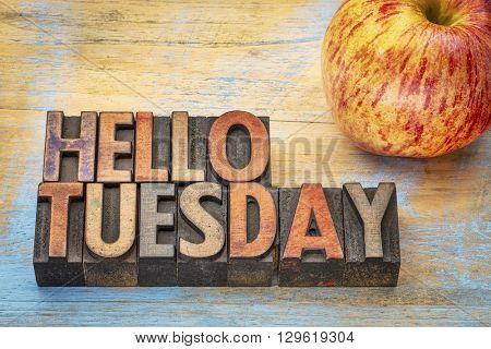 Hello Tuesday  - text in vintage letterpress wood type with an apple