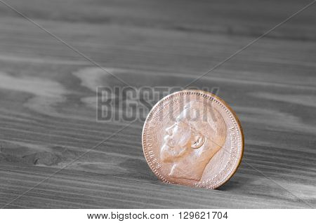 Ancient silver coin on a wooden table