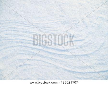 background of fresh white fresh snow. Natural texture.