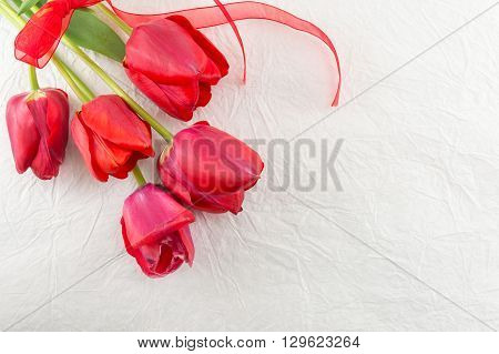 Red Tulips On A Silk Fabric