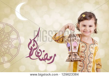 Ramadan Kareem - Translation : Muslim Holy Month Ramadan is generous - Happy young girl playing with Ramadan lantern