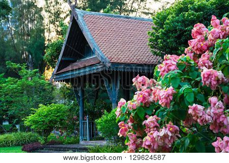 Big Wooden Asian Country Style Pavilion In The Beautiful Garden With Flowers