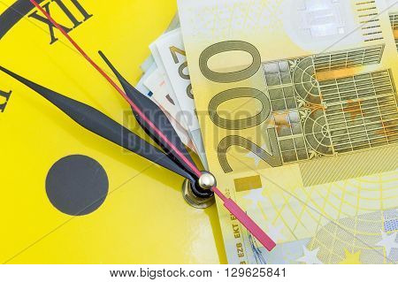 Euro Bills On Top Of The Clock