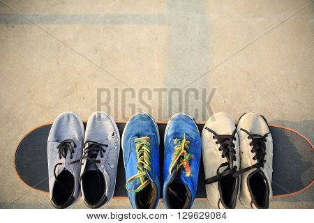 closeup of sneakers on skateboard at skatepark