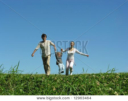 running family under clear sky