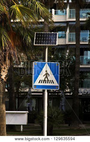 Crosswalk with solenchnoy battery on street in Spain
